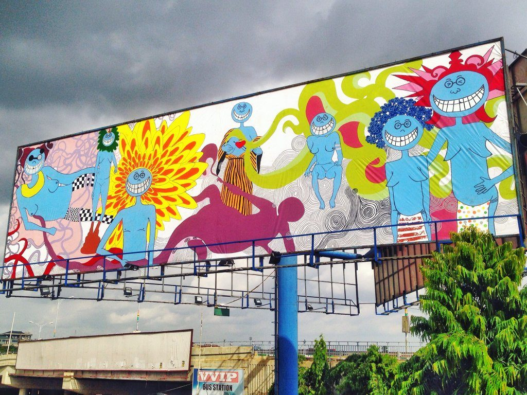 Adjo Kisser mural as a billboard in Kumasi.
