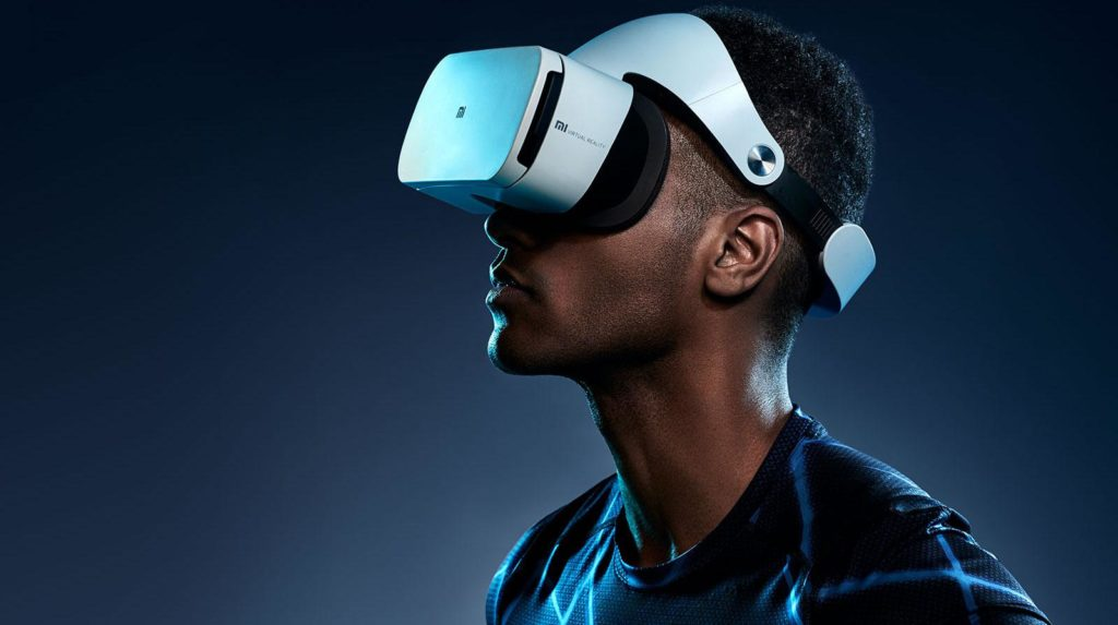 black man wearing a white Xiaomi VR headset experiencing virtual reality