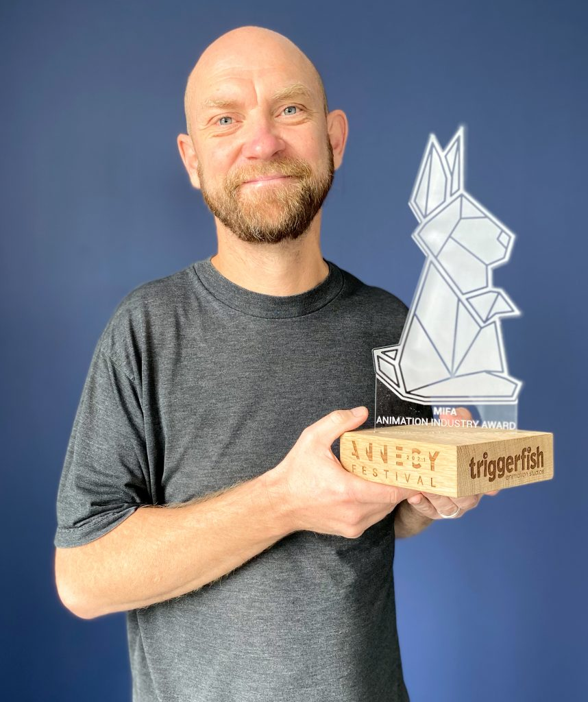 Annecy Industry Leader 2021 STUART FORREST holding the MIFA Animation Industry Award to Triggerfish as part of Annecy